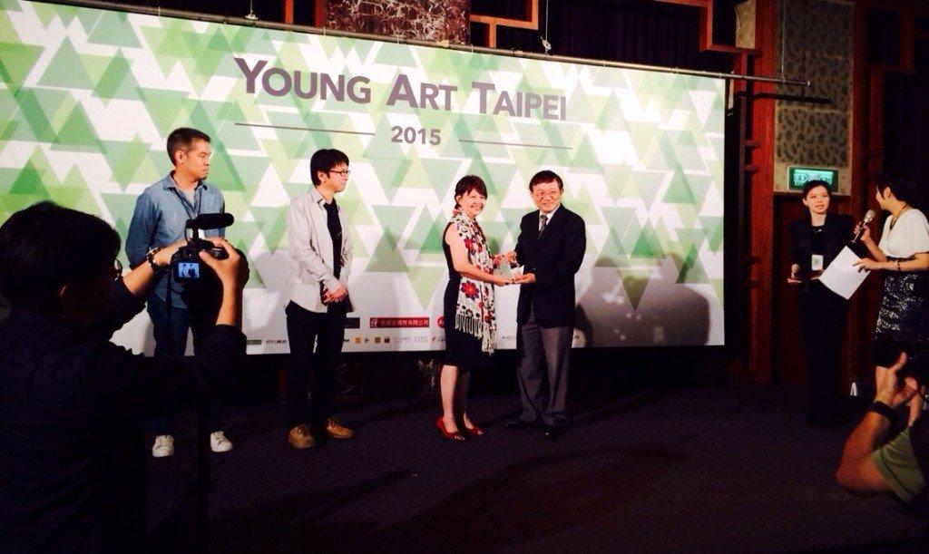 Receiving the award on behalf of Dedy Sufriadi
